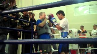 Manny Pacquiao finishes up on the mitts with Freddie Roach