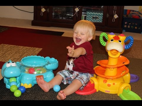 Fisher Price Go Baby Go Poppity Pop Dino & Sit-To-Stand Giraffe Comparison