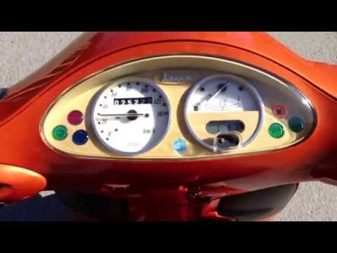 how to check piaggio fly 125 oil level