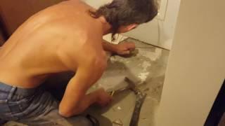 Installing Ceramic Tile in Kitchen - live footage of Master Carpenter