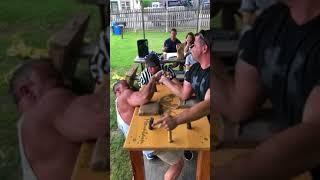 Team mates Dean Banaian and Brian Ramey arm wrestle
