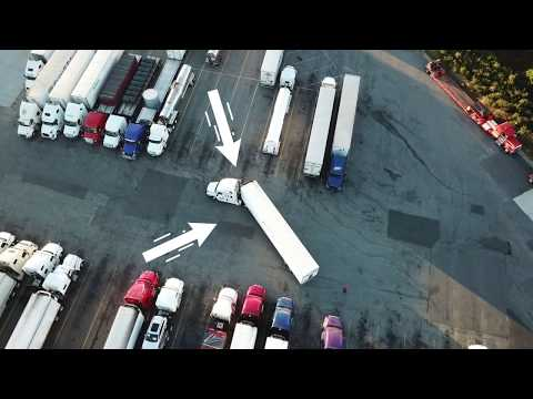 Truck Driving Student Backing At Truck Stop