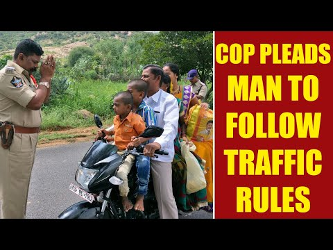 Andhra policeman stands infront of man asking to follow law, image go viral | Oneindia News