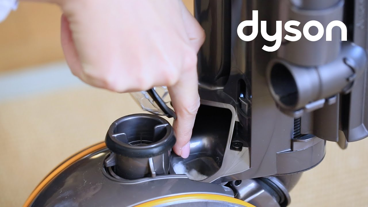 dyson ball™ multi floor 2 upright vacuum - checking the cleaner