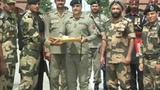 India-Pakistan border forces exchange sweets on Eid al-Fitr