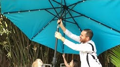 Amazing SOLAR powered LED lighted beach and patio+ more Tourke umbrella review