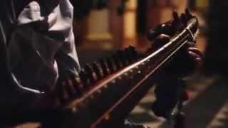 Pakistani Man Playing Traditional Rubab Instrument