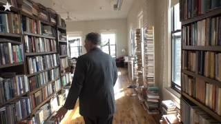 Floor to ceiling books fill Kemper's loft home