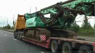 видео Транспортировка, доставка и перевозка бульдозера в Ярославле