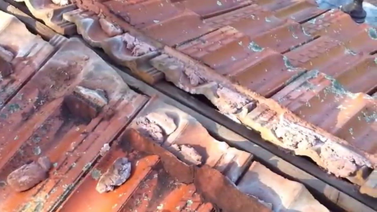 leaking tile roofing repair leaking ridge capping on a terracotta tile roof