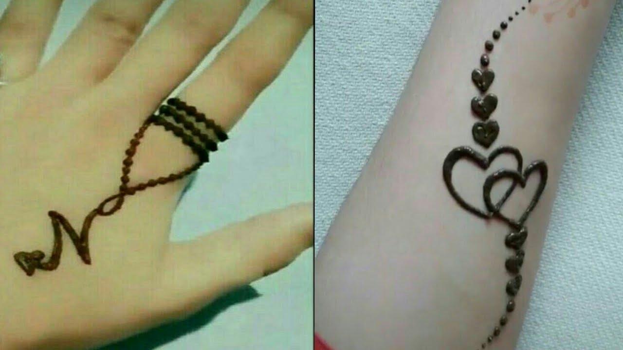 mehndi tattoo on hand