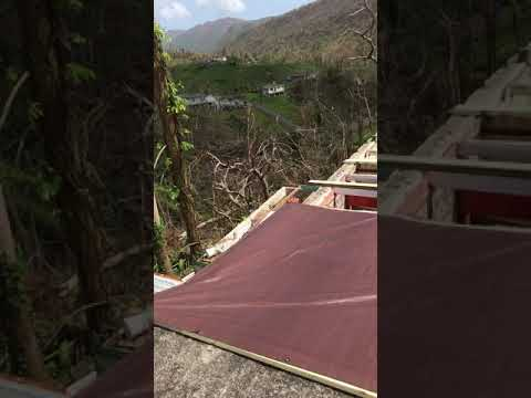 Temporarily covering destroyed roof with tarps. Hurricane Maria. Yabucoa Puerto Rico