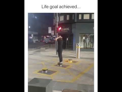 Guy stands on street barrier, when it comes out of the ground meme