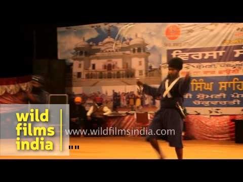Nihang warriors perform Gatka dance at Holla Mohalla in Punjab