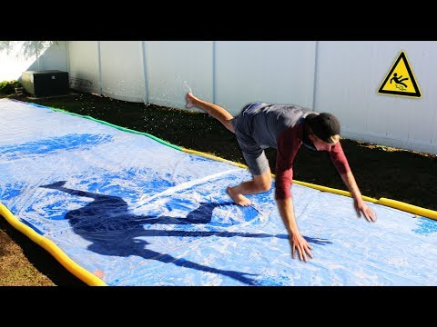 DONT Slip on the Slippery Platform!! (GIANT SLIP N' SLIDE CHALLENGE)