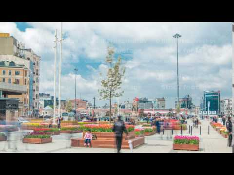 Taksim square timelapse, Istanbul, Turkey. Cars and people in the busy Taksim Square