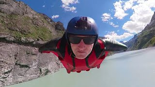 Wingsuit Flying Over a Dam Wall