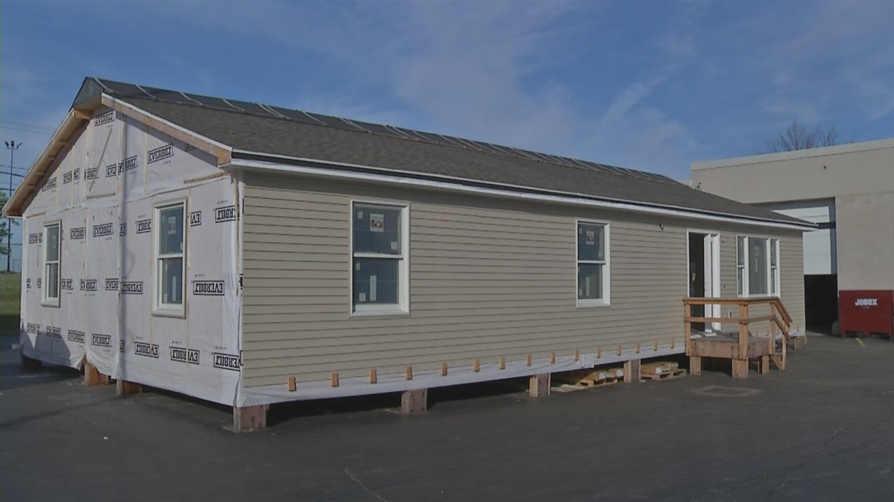 Download Student built home going up for auction
