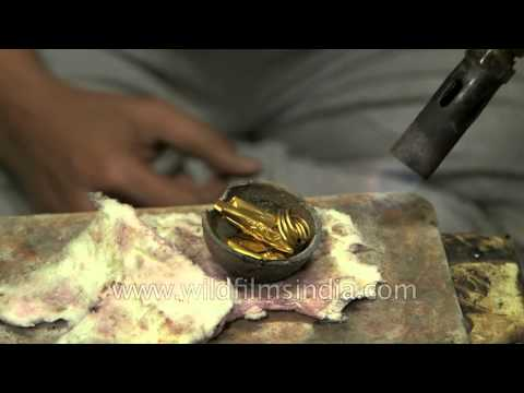 Smelting gold for making traditional Indian jewellery