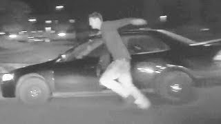 Car Thief Tries to Run Away From Police, Gets Pinned By Car