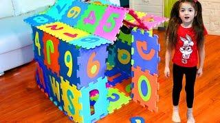 Masha and Vania play and build colored Playhouse