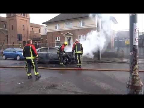 Firemen & Firefighters Extinguishing A Car Fire On Evelyn Road, Sparkhill, Birmingham, U K