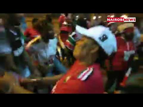 Kenyans celebrate their win against Tanzania in the streets of Cairo