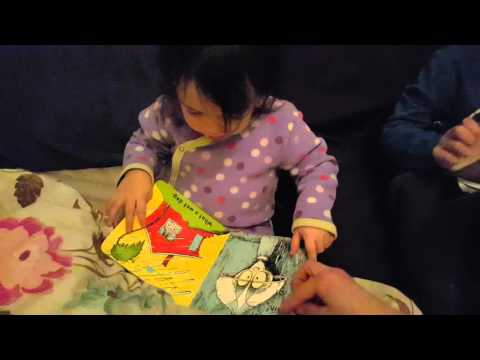 Elizabeth reading Wacky Weather book.