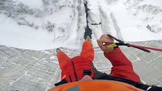 Base Jumper Leaps Off Snowy Dam