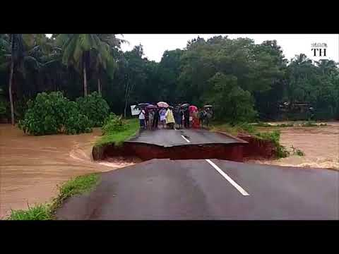 Kerala road cave-in as flood water rushes in