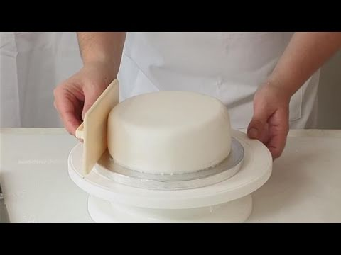 How To Wrap A Round Cake With Fondant Youtube