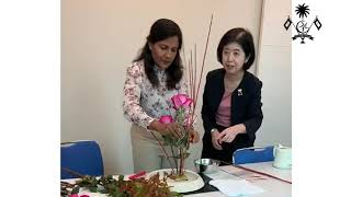 First lady observes traditional Japanese flower arrangement or 'ikebana' at Akasaka Palace in Tokyo