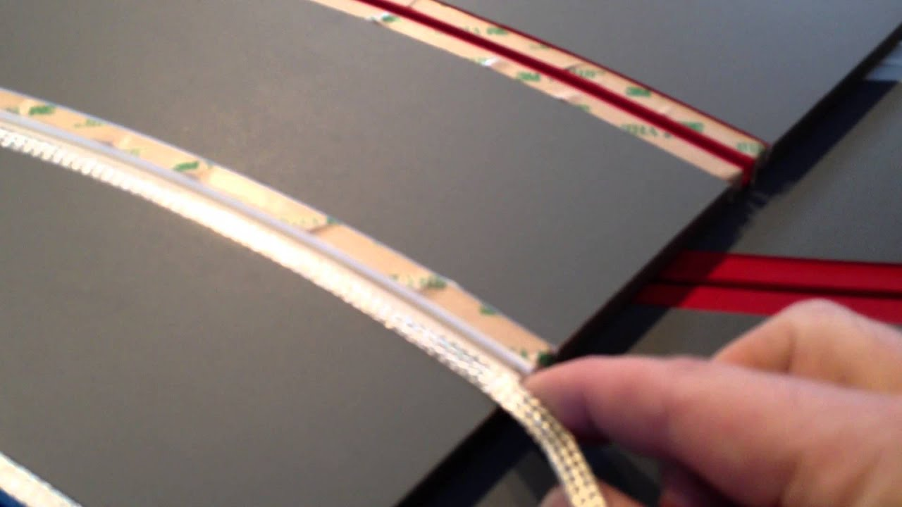 laying slot car braid on a routed track
