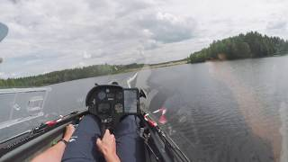 Glider low final over water