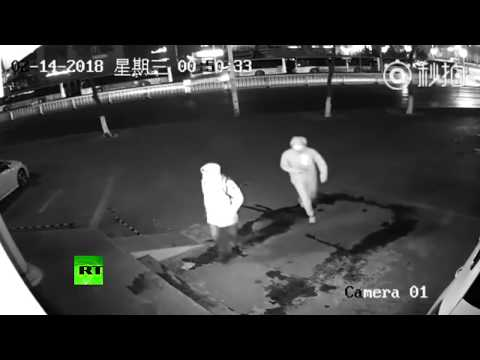 Dumbest burglars ever? Surveillance footage of failed robbery released by Shanghai police