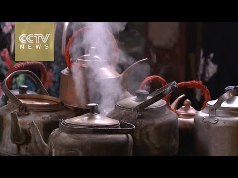 How will traditional teahouse businesses in China preserve their old-school charm?