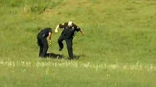Police Kicking, Tasering Man Lying on Ground (VIDEO)
