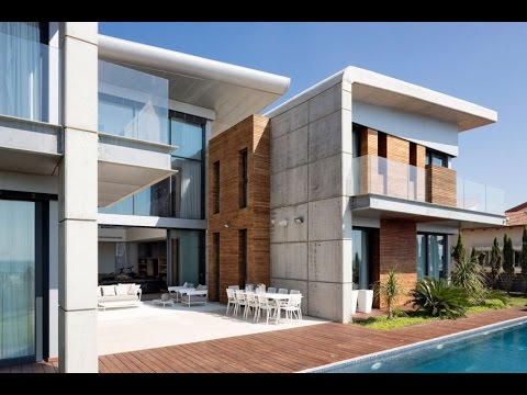 Contemporary House Design With Two Wings And Floating Roof Style