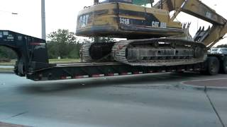 Ballsy  driver hauling heavy equipment