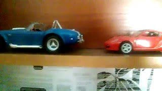 Обзор моего стеллажа с моделями автомобилей:)