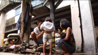 Harsh realities in the lives of Manila's migrants | Motorcycle Diaries