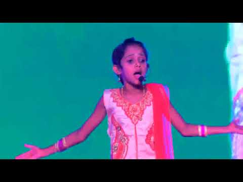 SSICS Girl performing a motivational speech in Kannada on school day function