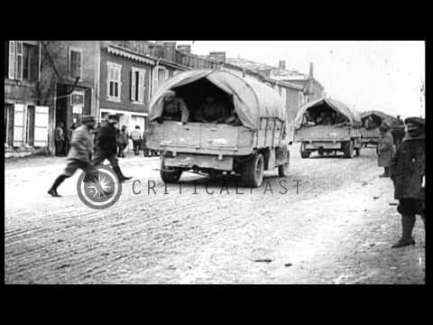 Line of French military troop transport trucks on streets of a a village in Franc...HD Stock Footage