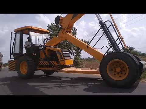 The JCB Is Pulled To Two Electric Pole's