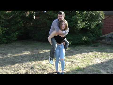 RLC146 Strong girl giving piggyback ride to a guy with sqats