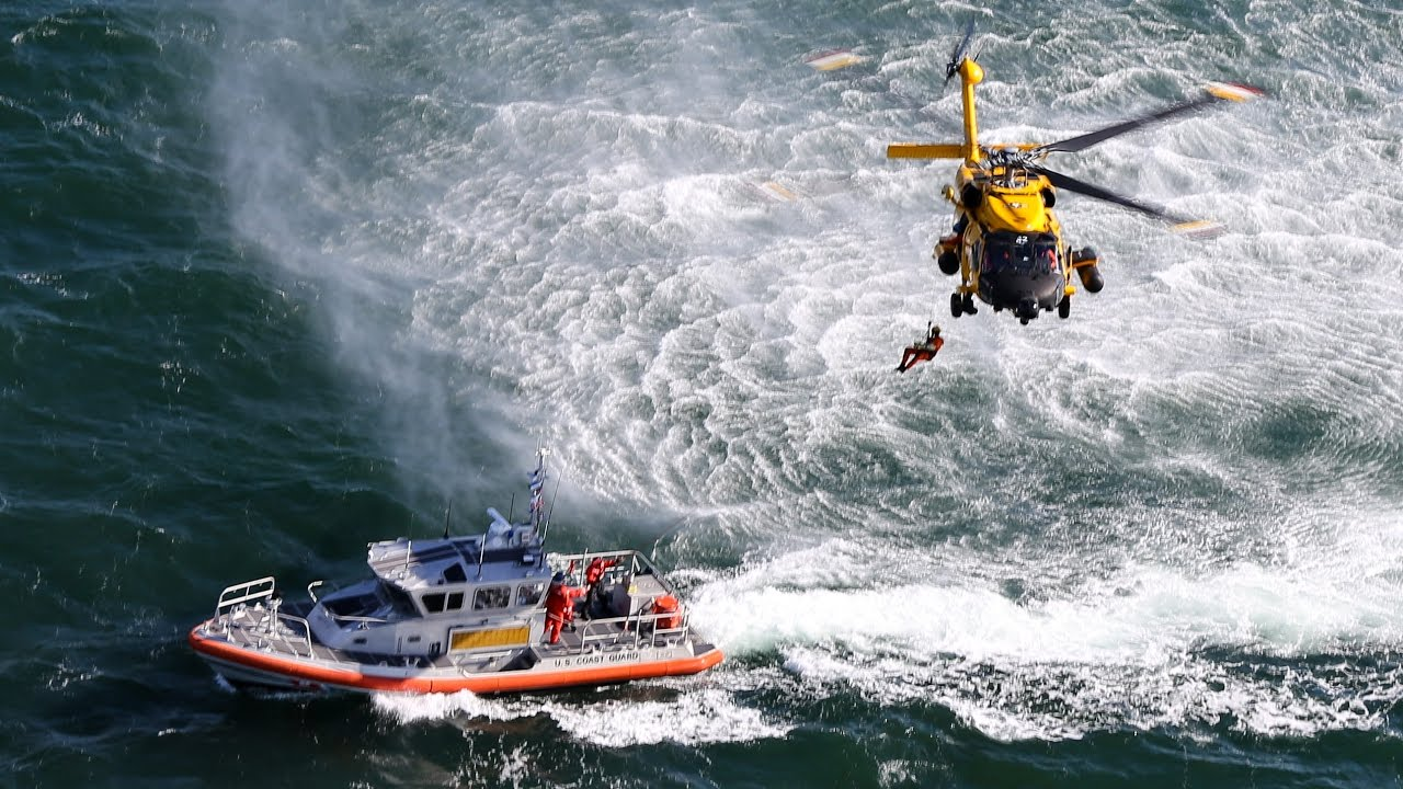 us coast guard rescue swimmer hoisting air station cape cod