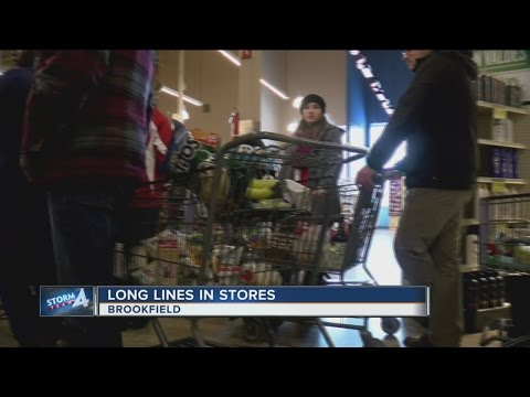 Shoppers pack grocery store in preparation for snow storm