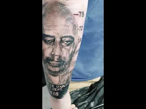Captain Spaulding mugshot tattoo