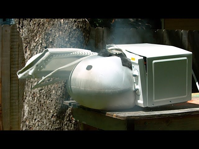 Microwaving an Airbag in Slow Motion - The Slow Mo Guys - 4K