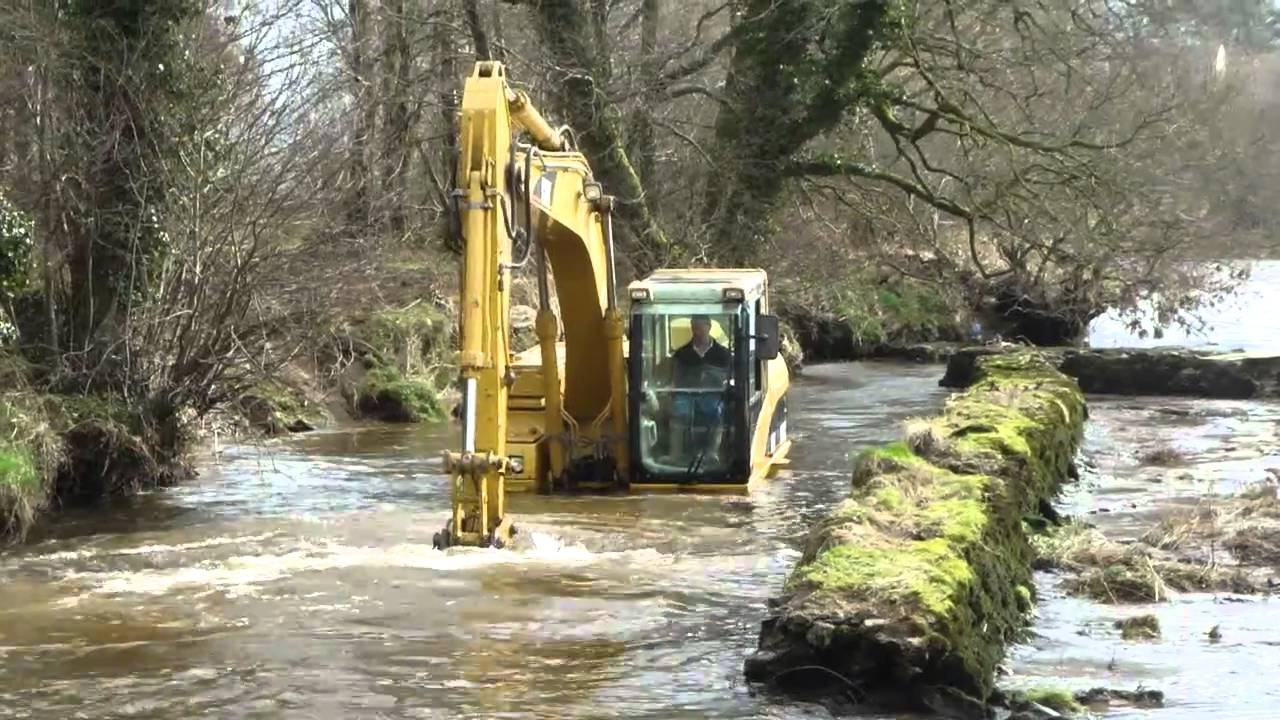 Cat 315cl excavator in deep water youtube for Pond equipment near me
